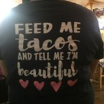 Exterior seating area-two styles of t-shirts for sale, my mothers enchiladas (ridiculously delic