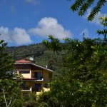 View of mountain Suites from front of Guayabo Lodge