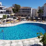 Spotlessly clean pool and pool terrace with ample sunbeds and parasols