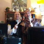 Party DJ and guest in Tudor dress