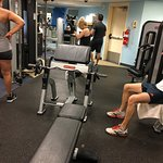 Inconsiderate Guy training person in gym