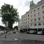 Exterior of hotel, from street. Metro/tram station across street, on left.