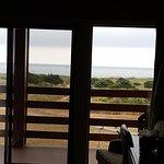 Tripe-wide patio looking past balcony toward ocean