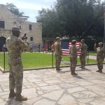 Army unit holding a small award ceremony out front of the Alamo