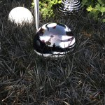 Space needle reflected in gazing ball at Chihuly Garden