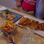 Seafood Basket consists of 4 crumbed whiting, 3 calamari, 2 prawns,chips, lemon + sauce