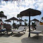 Sunbathing area by the heated pool.