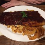 The enormous full rack of ribs ( chips underneath ).