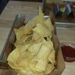 Basket of Chips and 1 of 4 salsas