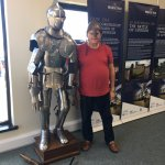 My husband having a bit of a laugh trying on the armour