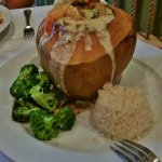 Camarao no Coco (Sautéed shrimps with mushrooms, herbs, coconut milk served inside coconut shell