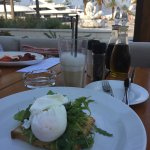 Avocado toast with a view of mega-yachts. Yummy coffee.