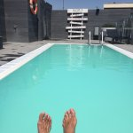 The rooftop pool was lovely (ignore the feet!)