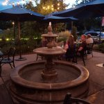 Outdoor patio area has a lovely fountain.