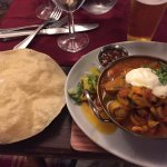 Shrimp curry with poppadom, with tasty mango chutney.