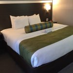 Newly furnished king size bed room with walking shower and HDTV