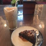 A chocolate cake and a marshmallow coffee drink