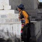 circling the stupa with prayer bell and mala