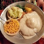Chicken fried round steak with cucumbers & onions and corn.