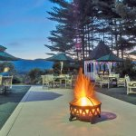 Garden dining with a view on the patio with fire pit