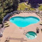 Aerial view of seasonal pool and hot tub
