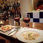 ravioli on left, shrimp past on right with sangria glasses