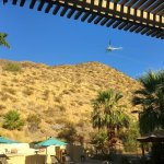 Helicopter insecticide spraying over the dining area during Breakfast