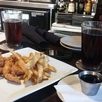chicken tenders with fries and honey-based sauce, with wo local beers