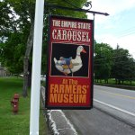 sign on street promoting the carousel