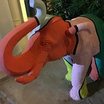 Colourfull baby elefant next to the entrance to the rooms