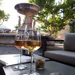 Enjoying a glas of rosé and champagne close to the villages fountain