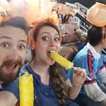Pineapple on chopsticks! Awesome seat neighbours!