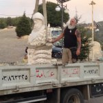 Unloading a new statue of St. Charbel