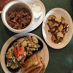Hearty oatmeal, veggie omelette, and yummy potatoes