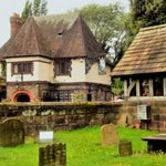 The Lych Gate with the George & Dragon beyond.