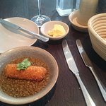 first course in two-course lunch menu: cod croquette on spiced lentils