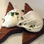 Poached eggs on brown toast.