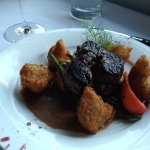filet with puffed potatoes and local vegetables.