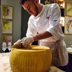 Nino opening a wheel of Parmigiano, done every couple weeks at our place