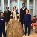 people pose with Lincoln family mannequins
