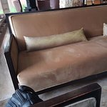 Couch in the lobby: do not miss the worn out wood