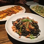 Wide pappardelle, black pasta, and risotto of the day