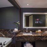 Luxuriate in the spa-like atmosphere of the Presidential Suite Bathroom with luxury linens.