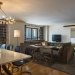 The Presidential Suite living area accommodations include seating for eight.