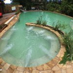 Our saltwater pool with water slide, swim-in jacuzzi, waterfall and kiddie pool!