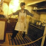 Ships chef balances the hot pans in the galley