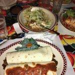 Two Carne Asada Burritos and a shredded beef tostada
