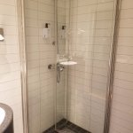 ...but they also close inwards to create more floor space when the shower is not in use.