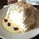 House Specialty Pavlova-fresh lemon crème anglais, raspberry coulis, whipped cream, toasted almo
