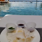 Coconut meat with limes, chili salt, Chamoy sauce poolside